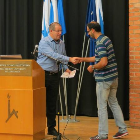 Yousef receiving the Functional Research prize 2014