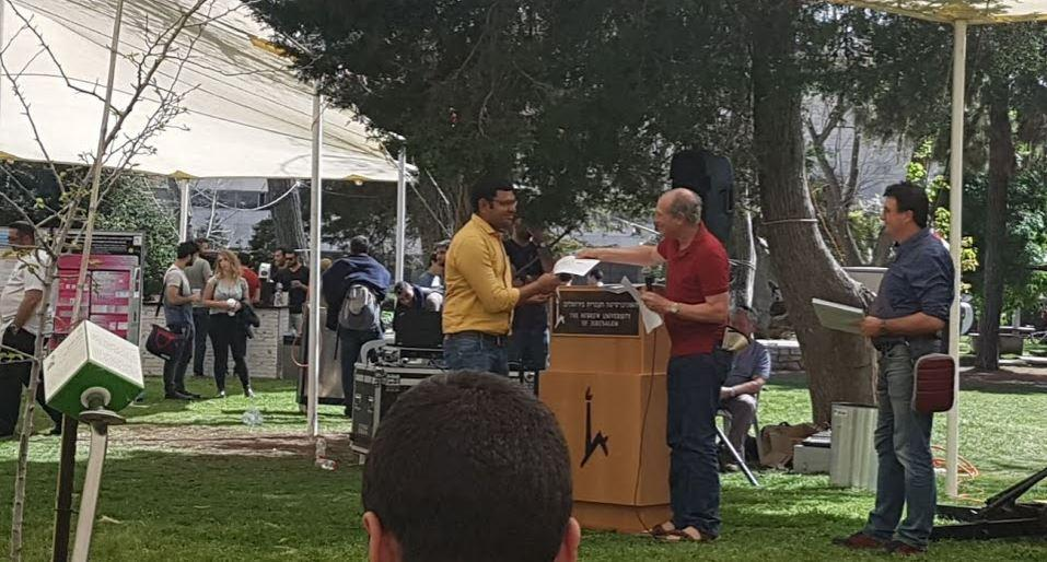 Dinesh winning prize