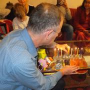 Lighting Hanukah candles